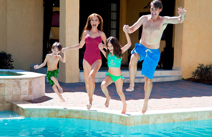 yes day family-jumping-into-pool